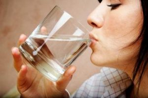 Woman sipping water from glass